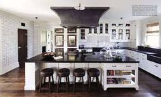 Absolute Black countertops, hood designed by John Toates, Grove brickworks from waterworks.