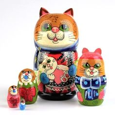 "Mamma Cat Nesting Doll - $37.99 This cute handmade ""Mamma Cat"" nesting doll stands about four inches tall, including the cute little ears that stick out. There are 5 cats total, each painted with many colors and small details. This kitty-cat nesting doll would be a wonderful gift for any cat lover! It is gloss finished and ready to ship!"
