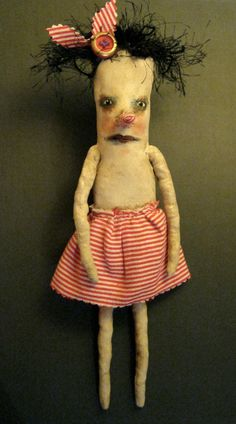 a weird art doll in red stripes, weird doll,bizarre ,spooky odd,sandy mastroni,