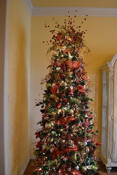 Kristens Creations: Decorating A Christmas Tree With Mesh Ribbon Tutorial.  There are tons of Christmas ideas on this blog.