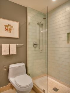 Greenish blue shower tiles with beige floor