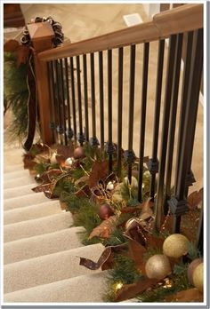 place garland at the base of the stair railing instead of on top or on the side