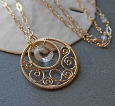 I love the use of filligree here! Gold Filled Circle Scroll Necklace