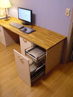 IKEA Hackers: work station from kitchen base cabinets. Very clever: drawers for printer, scanner and alike.