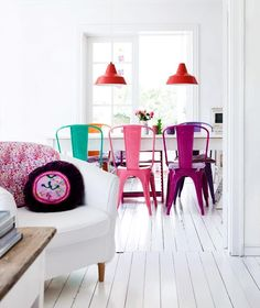 Floors, white table, coloured chairs