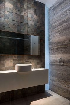 Minimalist Bathroom // stone walls and white sink in this Contemporary Home For … - Modern Minimalist Bathroom, Minimalist Decor, Bathroom Heat Lamp, Stone Bathroom, Bathroom Tiling, Sheffield Home, White Sink, Level Homes, Villa