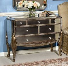 $1123.00 - Collette Hall Chest captures the timeless elegance of antique silvered mirror and handworked antique gold finished wood in the beautifully crafted piece.