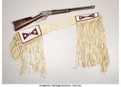 American Indian Art:Weapons, A BLACKFEET BEADED HIDE GUN CASE. . c.1910... (Total: 2 Items)