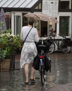 Zutphen. Every lady has her bike, well it is better than being a dump blonde at the wheel of Stupid 4x4