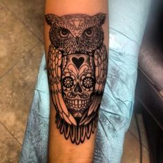 Loveee this tat. So unique with the sugar skull inside the owl.