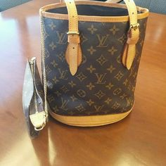 Louis Vuitton Bucket Bag Gorgeous authentic LOUIS VUITTON bucket bag in good used condition. Authentication code shown in the 2nd picture. Louis Vuitton Bags