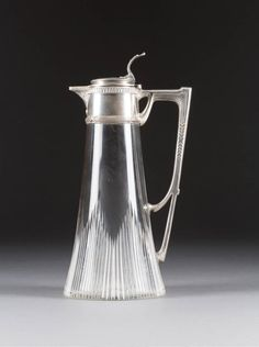 A FABERGÉ SILVER-MOUNTED CUT-GLASS DECANTER Moscow, 1908-1917. Colourless glass body of tapering form.