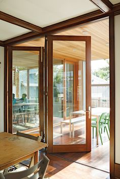 Modern Addition: Bifold Accordion Doors Connect Inside With Out.