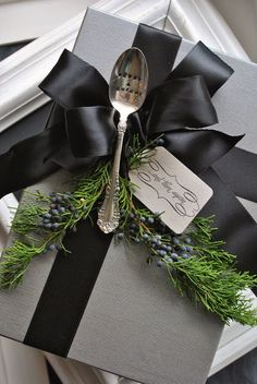 Add vintage flatware as an embellishment for a gift with a bit of evergreen.