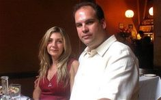 9/11 survivor tells how he 'surfed' 15 floors down the collapsing tower: Mr Buzzelli and his wife Louise