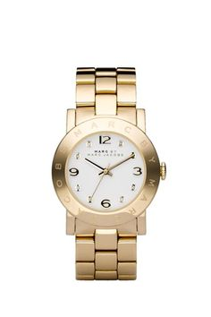 Marc by Marc Jacobs Amy watch steel bracelet. White dial with gold hands and  gold applied 12,3,6 and 9 and 8 pave stones at all other hours.