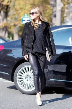 Olivia Palermo sports a black fall outfit with a suede, black fringed jacket and knit.