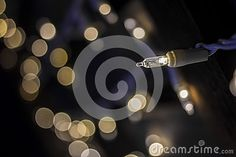 Single white light and background bokeh.  Light for holiday or for party. Landscaping lights, fairy lights, twinkle lights.