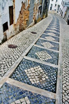 "The famous Portuguese cobblestone pavement (""calcadas"") in Belèm ~ photo by Sabine Ostermann www.pure-image.eu"