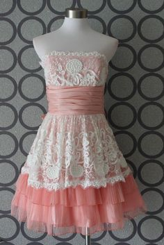 the pink/white version of my wedding dress (wish it was black lace overlay while white....would be perfect bridesmaids dresses!) betsey johnson