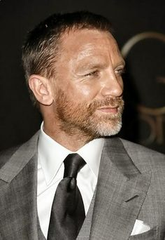 Daniel Craig grey worsted silver suit and white shirt. Can't go wrong with the peak lapel or vest either.