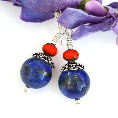 The dark lapis lazuli used in the handmade ENCHANTMENT earrings looks as if it has been scattered with sparkling stars. Bali style sterling silver filigree bead caps at beauty and faceted deep orange Czech glass rondelles add a vibrant pop of color.