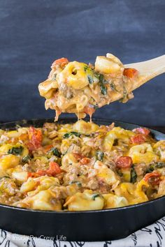 This Bacon Cheeseburger Skillet Tortellini is full of meats, veggies, and gooey cheese. Easy comfort food on a busy night makes everyone smile at dinner.