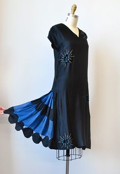 Black and blue silk dress with bead and pompom decoration and scalloped-hem skirt inserts (showing scalloped skirt), 1920s.