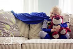 Little boys being boys.  Love that even a super hero needs a stuffed animal.