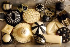 Celluloid buttons in black and cream by calloohcallay, via Flickr