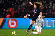 Paris Saint-Germain's Brazilian defender David Luiz (L) vies for the ball with Lille's French defender Sebastien Corchia during the French L1 football match between Paris Saint-Germain (PSG) and Lille (LOSC) at the Parc des Princes stadium in Paris, on February 13, 2016.