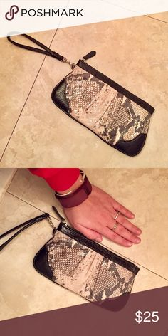Wilsons Leather wristlet Adorable wristlet with a shimmer to it in the light. Silver hardware. Black and cream in color. Excellent condition. Hand there for size comparison (I have guy size hands lol) Wilsons Leather Bags Clutches & Wristlets