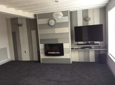 Scaffold plank feature wall painted in various tones of grey