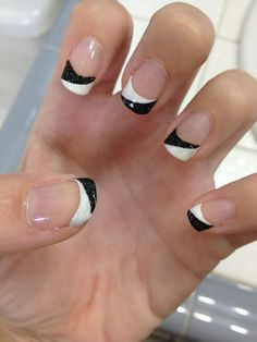 A very quirky French tip including a white and black combination. The nails are coated with clear nail polish as base and tipped with a combination of white and black overlapping each other. The black parts are also accented with glitters for effect.