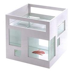 Fish Hotel - Teddy Luong: Units can be stacked for a multistory version. Glass with white, ABS plastic.