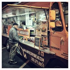 howard-f | what's cooking? | street scene + man food truck black white brown yellow blue green