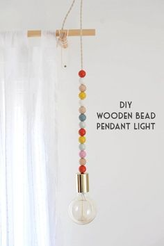 Check out this easy idea on how to make a #DIY wooden bead light #DIYHomeDecor #HomeDecorIdeas @istandarddesign