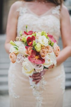 Beautiful summer bouquet of roses, peonies and orchids for a Paris vow renewal.