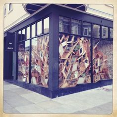 you could totally do this with slices of cardboard boxes. RVCA window in San Francisco | RVCA