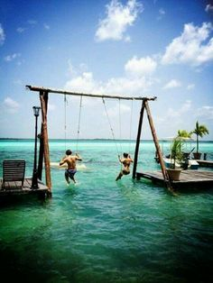 Swinging in the ocean. In the unlikely event I ever get a beach house, this will be the first thing I do!