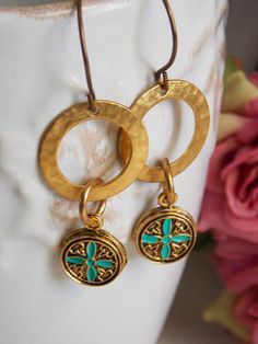 """You will find these brass earrings are just bold enough for that """"wow"""" factor. Brass hoops are complimented with gold pewter charms with a hint of turquoise. Pair these wit..."""