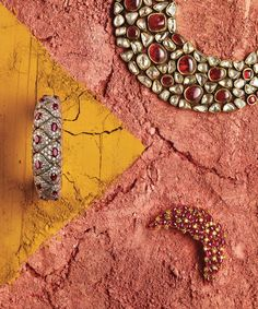 Intricate compositions of precious stones and carved gold that evoke the splendors of the Mughal Empire.