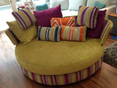 Large swivel loveseat 175 cm wide x 130 cm deep.  May also be ordered as a static base, but that seems much less fun!