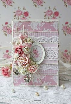 Pretty handmade card. Those roses are so pretty and I love the pearls tucked in amongst them.  Also the little charm is cute.