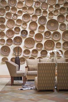African basket wall decor design | #myjabulani #jabulanicreations #livingroomdecor #homedecor #basketwall African Themed Living Room, African Interior Design, Wall Decor Design, Basket Decoration, Baskets On Wall, Hudson Table, Room Decor, Villa Design, Goa