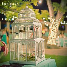 Birdcage Chandelier. So different. So brilliant. So easy. (if you can find a cage as perfect as the one featured...)