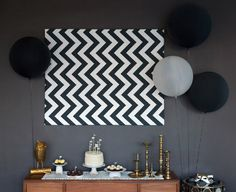 A cake display of chevron and gold...