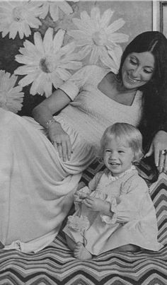 Cher and Chastity Bono ~1970s  WHO WOULD HAVE EVER THOUGHT, THIS PRETTY LITTLE GIRL BECAME A NICE YOUNG MAN.......ccp