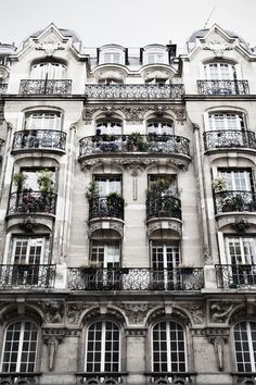 Parisian Apartment... Love all those little windows in the early morning
