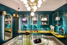 Baciocchi Associati combines a vivid colour palette with signature brass elements for luxury retail - News - Frameweb